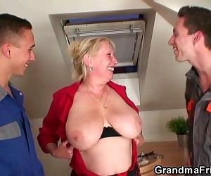 Naughty granny pleases two repairmen - 6 min